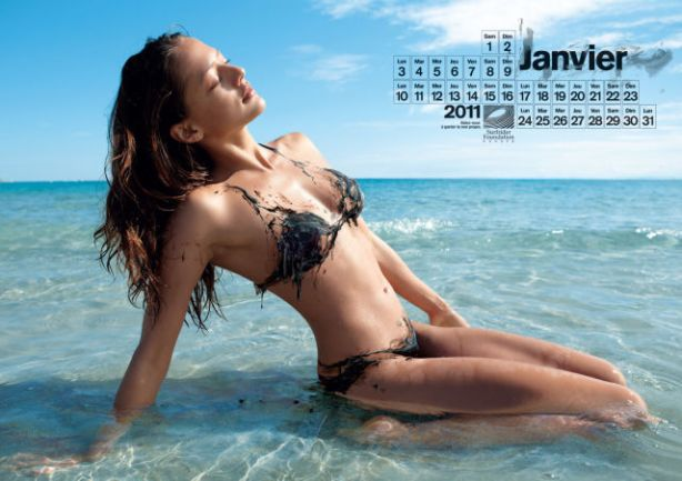 lolmetechie_surfing_calendar_puts_hot_chicks_in_oil_swimsuits_640_02